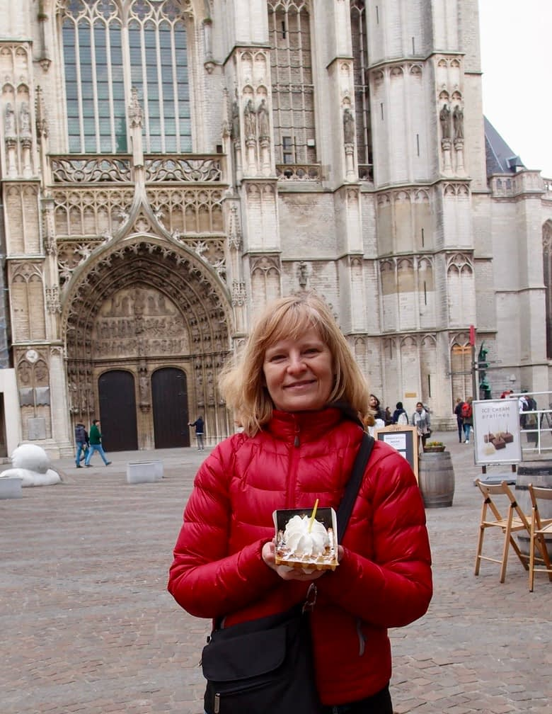 eating a waffle in front of a cathedral