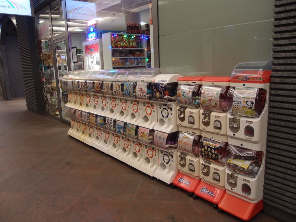 gashapon vending machines in a train station