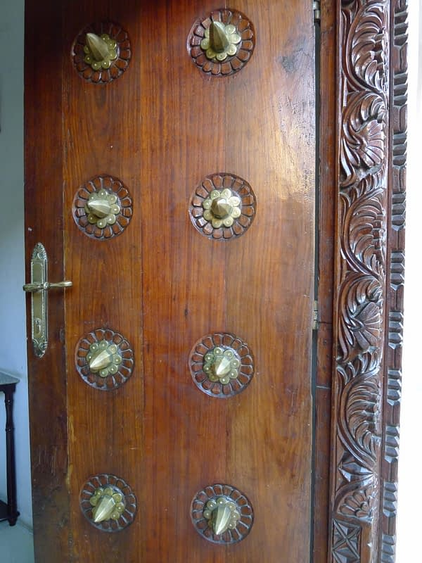 Zanzibar doors with brass knobs