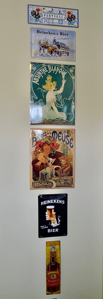 metal signs lined up on a wall