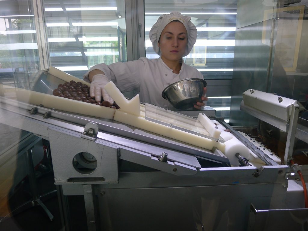 woman making chocolates in the Lindt Chocolate Museum