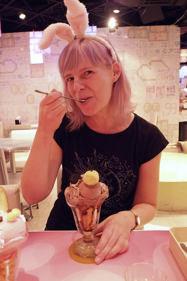 eating sundae with bunny ears on at a maid cafe Tokyo