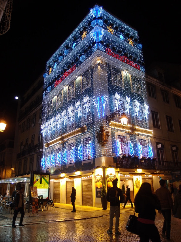 Christmas lights on a building in Lisbon at night